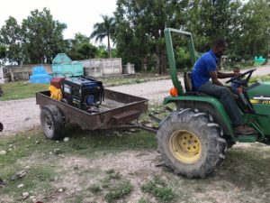 tractor moves generator from post to post